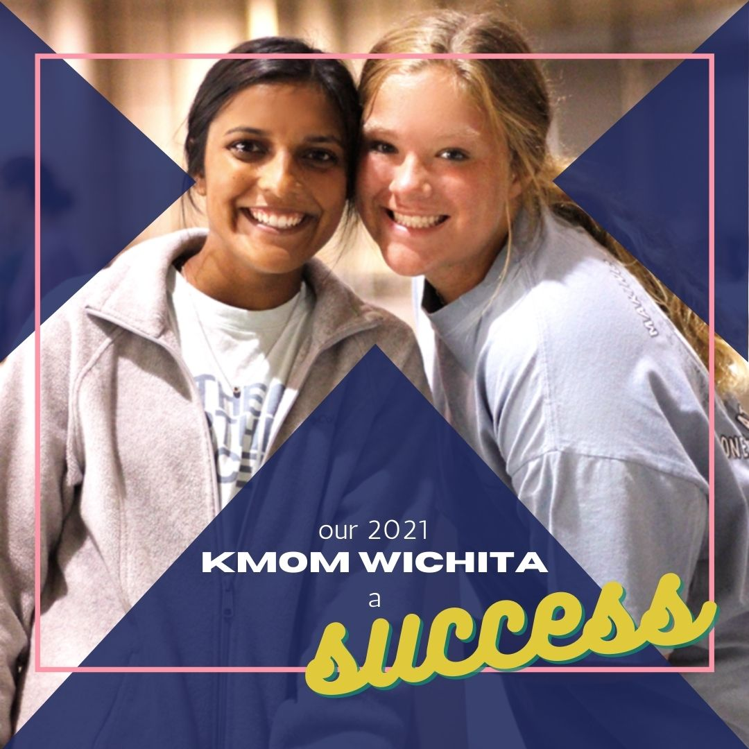 2021 KMOM Wichita a Success. Two volunteers smiling.